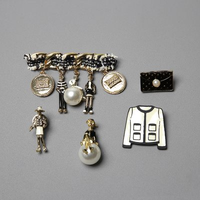 many coco brooch
